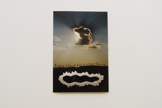 Brooch, 'Every cloud has a silver lining', on package 1998. silver, � 165,-